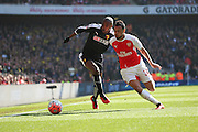 Arsenal midfielder, Francis Coquelin (34) battling for ball wit Watford striker, Odion Jude Ighalo (24) during the The FA Cup Quarter Final match between Arsenal and Watford at the Emirates Stadium, London, England on 13 March 2016. Photo by Matthew Redman.