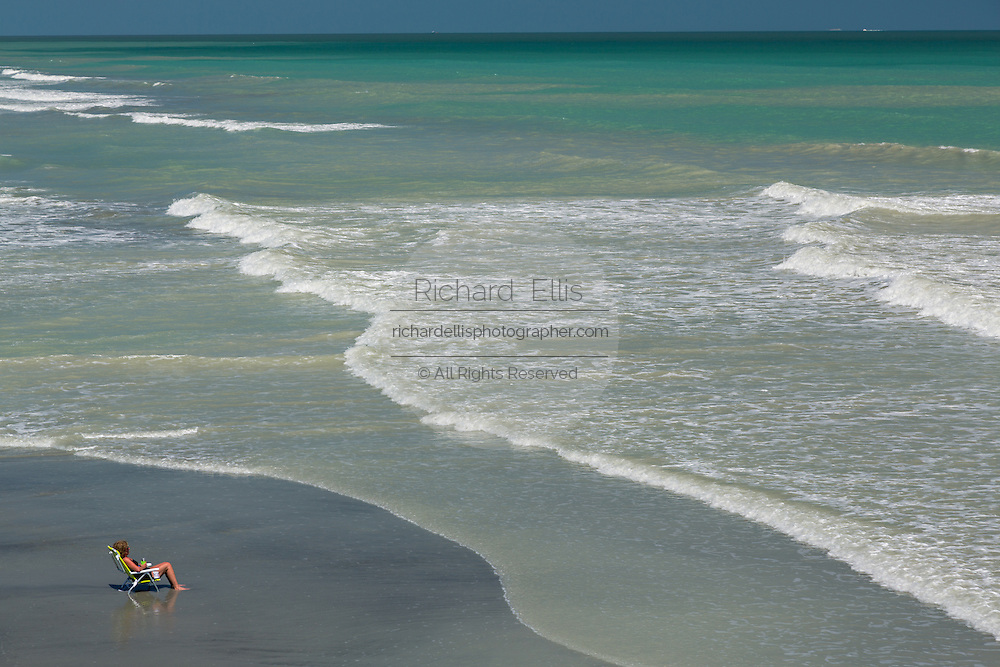 A woman relaxes on the newly replenished beach in Folly Beach , SC.
