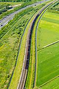 Nederland, Gelderland, Gemeente Zaltbommel, 23-08-2016; Rijksweg A15 ten westen van knooppunt Deil . Parallel aan de snelweg de Betuweroute met goederentrein (kolen en/of erts), richting haven van Rotterdam.<br /> Main motorway A15 (Rotterdam Harbour - Germany) with Betuweroute, freight railway w coal train <br /> <br /> aerial photo (additional fee required); luchtfoto (toeslag op standard tarieven); copyright foto/photo Siebe Swart