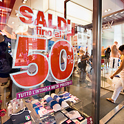 MILAN, ITALY - JULY 03:  A woman walks into a shop on the first day of the Summer Sales in the fashion shopping area of Milan on July 3, 2010 in Milan, Italy. Milan's summer sales start today. .***Agreed Fee's Apply To All Image Use***.Marco Secchi /Xianpix. tel +44 (0) 207 1939846. e-mail ms@msecchi.com .www.marcosecchi.com