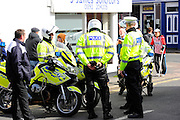 Police out in force for the Sky Bet League 2 match between Exeter City and Plymouth Argyle at St James' Park, Exeter, England on 2 April 2016. Photo by Graham Hunt.