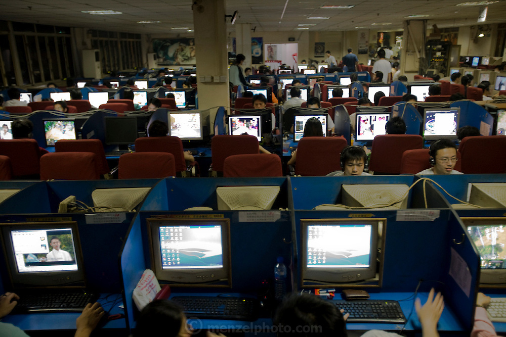 Ming Wang Internet cafe in Shanghai, China, where extreme gamer Xu Zhipeng rents a chair for six months at a time and continuously plays games. His longest continuous game lasted three days and nights. China has more than 300 million Internet users; a number close to the entire population of the United States. (Xu Zhipeng is featured in the book What I Eat: Around the World in 80 Diets).