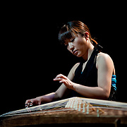 "April 9, 2011 - Manhattan, NY : Yumi Kurosawa plays the 20-string koto during the Japan Society's all-day special ""Concert For Japan"" charity event on Saturday. (This was taken during the Open Concert: Japanese Traditional Music set)... CREDIT: Karsten Moran for The New York Times."
