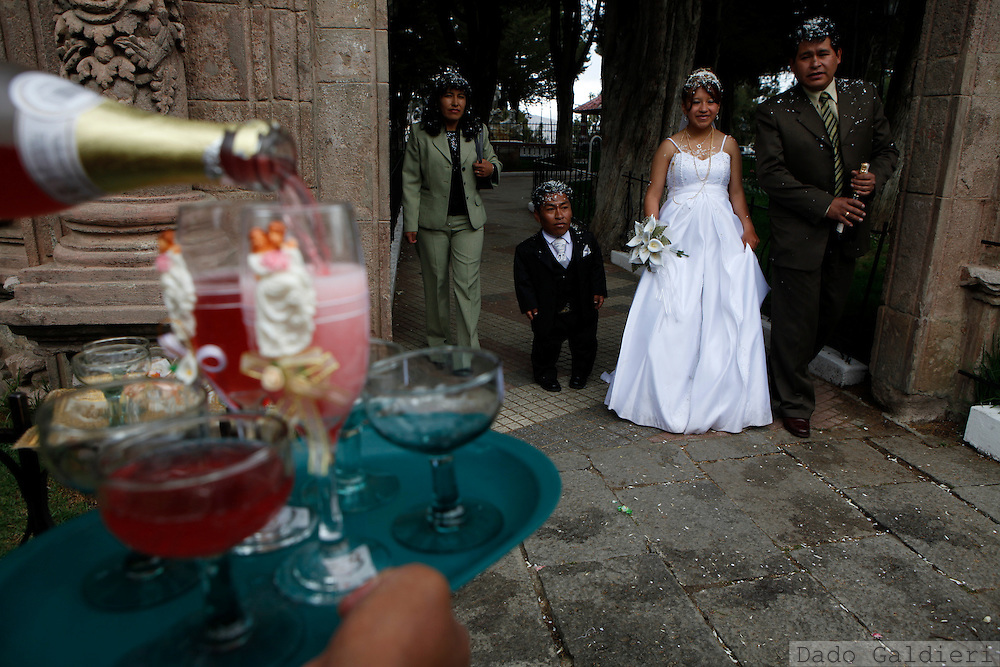 Cresencio Choque and his wife  Ysabel walk on a square prior toasting for their marriage in the city of La Paz, Saturday, Dec. 19, 2009