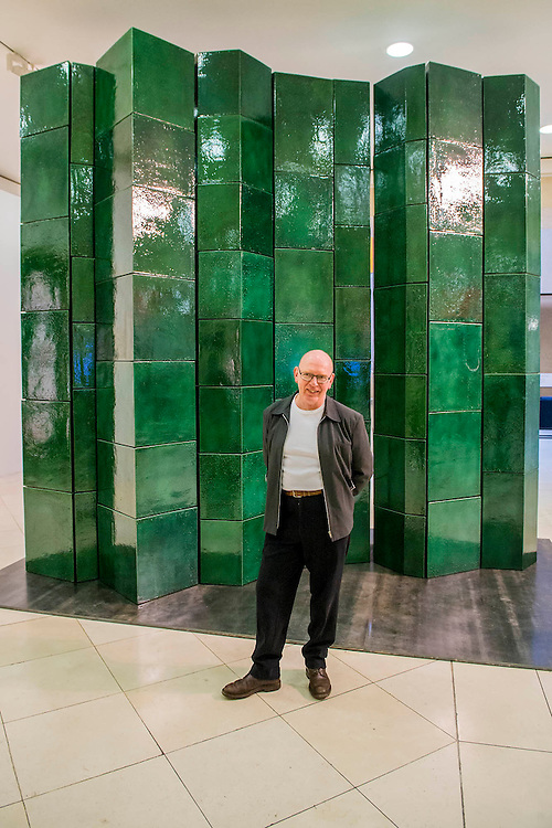 Tate Britain launches its major spring show, exhibiting the work of Turner Prize-winning artist Richard Deacon (b.1949 - pictured). It includes large sculptures made of twisted wood, metal, and ceramic such as: Fold 2012, a towering sculpture weighing over 12 tonnes and made of 60 shimmering glazed ceramic bricks (pictured); After 1998, a huge serpentine wooden structure that is over 9 metres at its longest point; and Out of Order 2003, a sprawling sculpture constructed from ribbons of steamed wood. The Tate Britain, London, UK 03 February 2014. Guy Bell, 07771 786236, guy@gbphotos.com