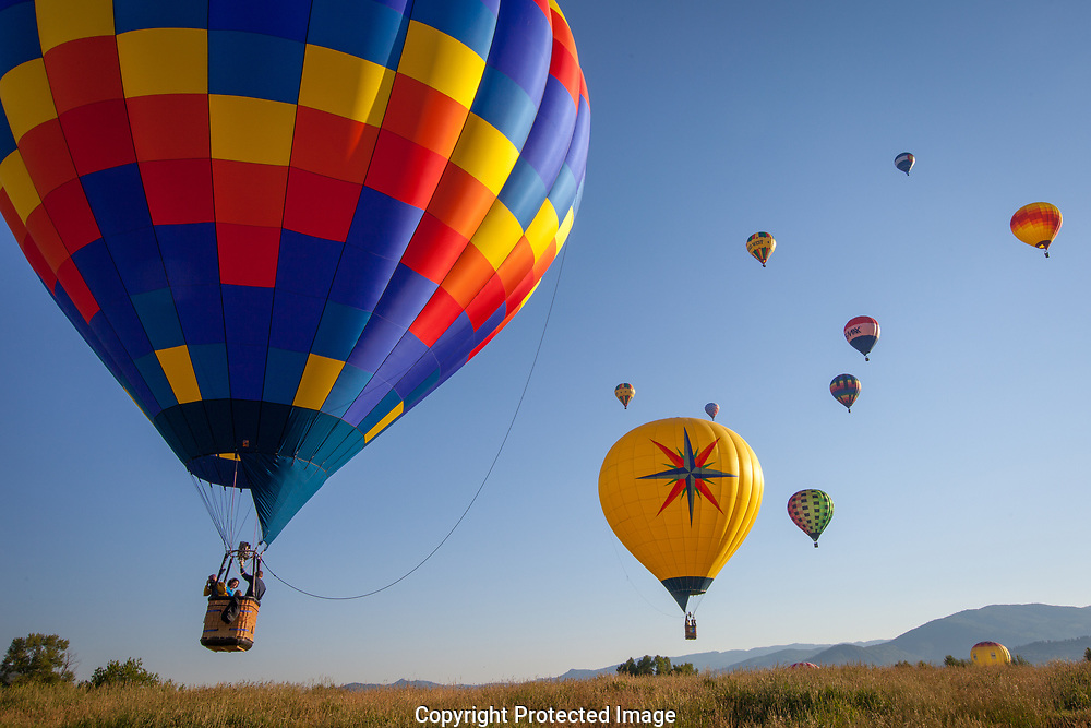 Colorful hot air balloons take to the sky during the annual Hot Air Balloon Rodeo in Steamboat Springs, CO.