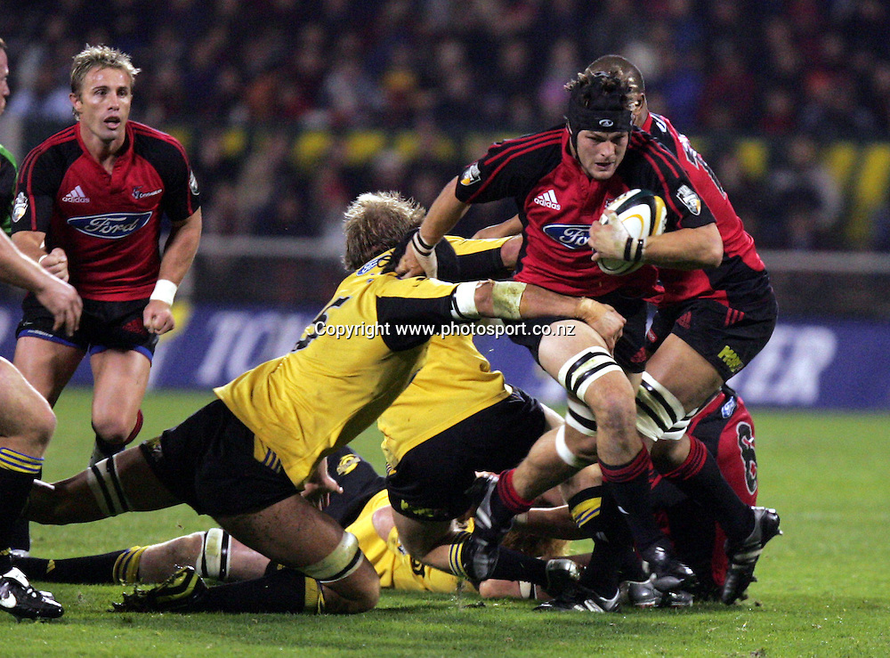 Ritchie McCaw attacks during the Round 12 Super 12 match between the Crusaders and the Hurricanes at Jade Stadium, Christchurch, New Zealand on Friday 13 May, 2005. The Crusaders won the match, 40 - 20. Photo: Hannah Johnston/PHOTOSPORT