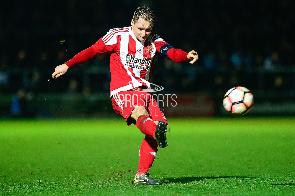 Stourbridge FC midfielder Tom Tonks (4) shoots during the The FA Cup match between Wycombe Wanderers and Stourbridge at Adams Park, High Wycombe, England on 7 January 2017. Photo by Dennis Goodwin.