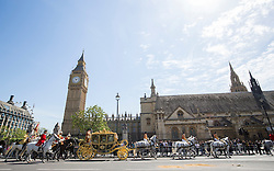LONDON - UK- 27- MAY -2015:  HM Queen Elizabeth arrives by carriage at the Palace of westminster for the annual State Opening of Parliament Ceremony.<br /> Photograph by Ian Jones