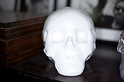 overexposed fake human skull made from white porcelain