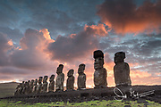 Carved statues known as Moai stand in a row at Ahu Tongariki on Easter Island, Chile.