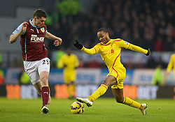 BURNLEY, ENGLAND - Boxing Day, Friday, December 26, 2014: Liverpool's Raheem Sterling in action against Burnley during the Premier League match at Turf Moor. (Pic by David Rawcliffe/Propaganda)