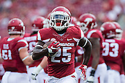FAYETTEVILLE, AR - SEPTEMBER 5:  Denzeil Evans #25 of the Arkansas Razorbacks warms up before a game against the UTEP Miners at Razorback Stadium on September 5, 2015 in Fayetteville, Arkansas.  The Razorbacks defeated the Miners 48-13.  (Photo by Wesley Hitt/Getty Images) *** Local Caption *** Denzeil Evans