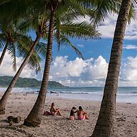 Afternoon chill-out scene at Banana Beach on Playa Carmen in Santa Teresa, Costa Rica.