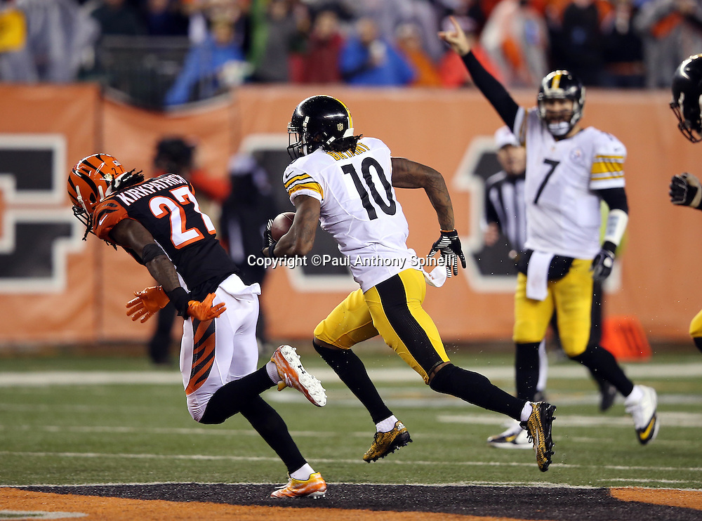 Cincinnati Bengals cornerback Dre Kirkpatrick (27) gives chase as Pittsburgh Steelers quarterback Ben Roethlisberger (7) points in the background while Pittsburgh Steelers wide receiver Martavis Bryant (10) runs a third quarter reverse for a gain of 44 yards and a first down at the Cincinnati Bengals 20 yard line during the NFL AFC Wild Card playoff football game against the Cincinnati Bengals on Saturday, Jan. 9, 2016 in Cincinnati. The Steelers won the game 18-16. (©Paul Anthony Spinelli)