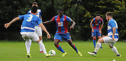 Sullay KaiKai taking on the QPR defence during the U21 Professional Development League match between U21 QPR and U21 Crystal Palace at the Loftus Road Stadium, London, England on 31 August 2015. Photo by Michael Hulf.