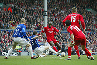 Photo: Andrew Unwin.<br />Liverpool v Everton. The Barclays Premiership. 25/03/2006.<br />Liverpool's Momo Sissoko (C) in action.