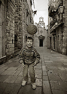 Boy with football. Dubrovnik, Croatia. (Photo by Robert Falcetti)