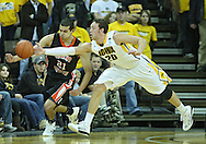 December 04 2010: Iowa Hawkeyes forward Andrew Brommer (20) gets his hand on the ball as Idaho State Bengals forward/center Abner Moreira (21) looks on the second half of their NCAA basketball game at Carver-Hawkeye Arena in Iowa City, Iowa on December 4, 2010. Iowa won 70-53.
