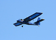 Large blue ultra light plane giving air tours of Jekyll Island.