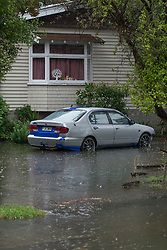 Flood water creeps into a property from the Heathcote River in Opawa, Christchurch, New Zealand, Friday, January 5, 2018. Credit:  SNPA / David Alexander