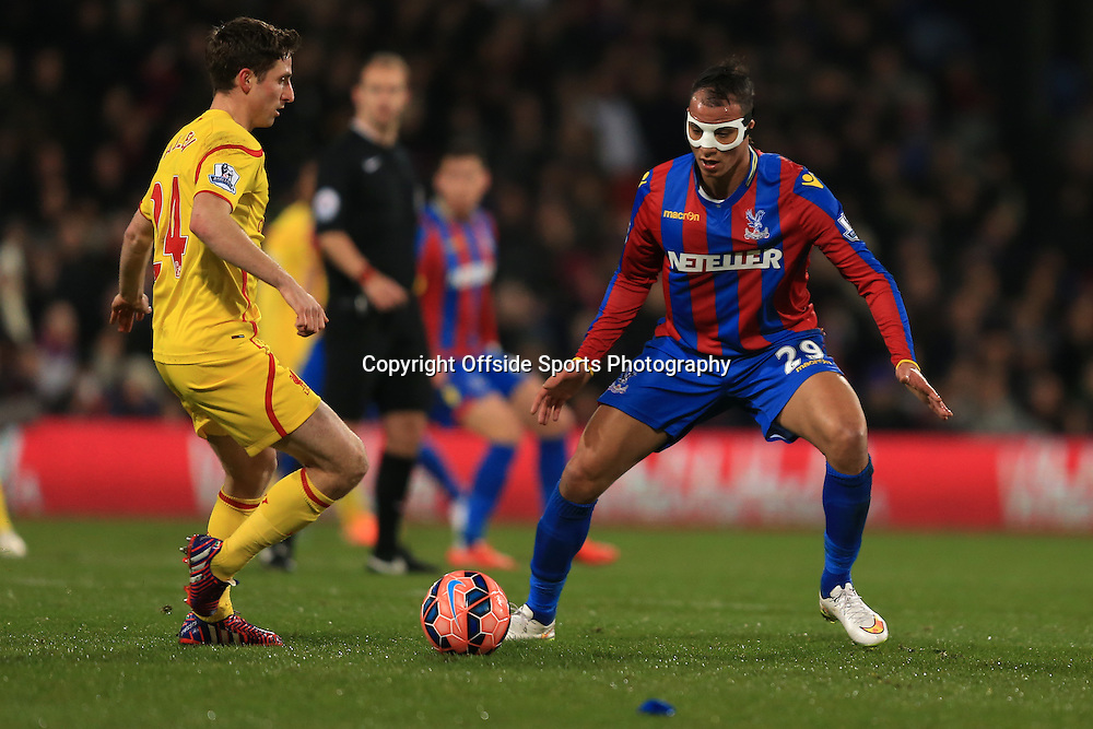 14 February 2015 - The FA Cup Fifth Round - Crystal Palace v Liverpool - Marouane Chamakh of Crystal Palace wearing a protective face mask keeps an eye on Joe Allen of Liverpool  - Photo: Marc Atkins / Offside.