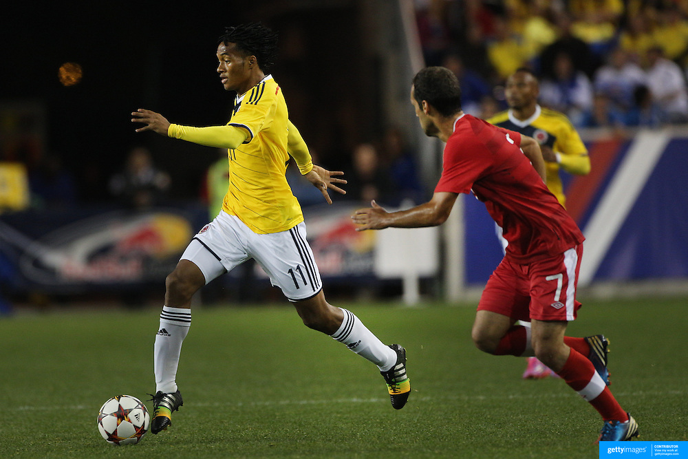 Juan Cuadrado, Colombia, in action during the Columbia Vs Canada friendly international football match at Red Bull Arena, Harrison, New Jersey. USA. 14th October 2014. Photo Tim Clayton