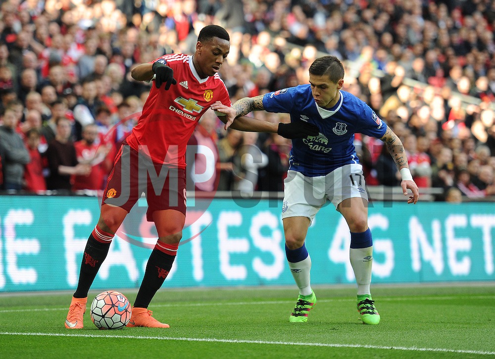 Anthony Martial of Manchester United Battles for the ball with Muhamed Besic of Everton - Mandatory by-line: Alex James/JMP - 23/04/2016 - FOOTBALL - Wembley Stadium - London, England - Everton v Manchester United - The Emirates FA Cup Semi-Final
