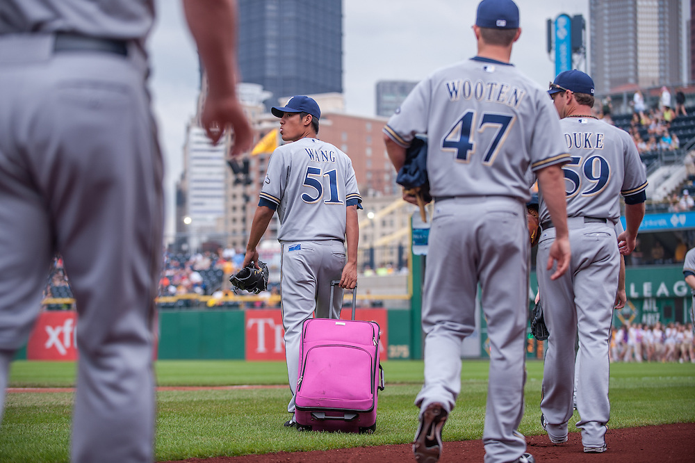 PITTSBURGH, PA - JUNE 08: Wei-Chung Wang #51 and other members of the Milwaukee Brewers roll a pink suitcase to the bullpen before the game against the Pittsburgh Pirates at PNC Park on June 8, 2014 in Pittsburgh, Pennsylvania. (Photo by Rob Tringali) *** Local Caption *** Wei-Chung Wang
