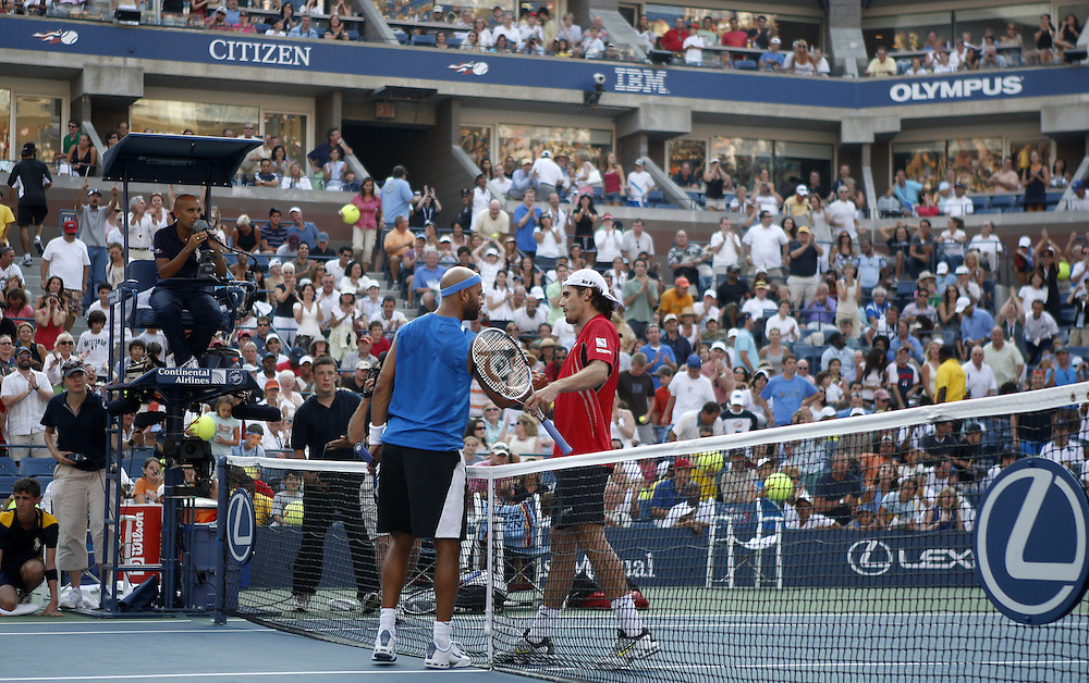 Tommy Haas of Germany (R) and James Blake of the US (L) shake hands at the net after Haas' ace was upheld after review to end their fourth round match on the eighth day of the 2007 US Open tennis tournament in Flushing Meadows, New York, USA, 03 September 2007.