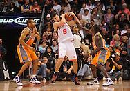 Mar. 26 2010; Phoenix, AZ, USA; New York Knicks forward Danilo Gallinari (8) fights for a rebound against Phoenix Suns guard Jason Richardson (23) in the second half at the US Airways Center.  The Suns defeated the Knicks 132-96.  Mandatory Credit: Jennifer Stewart-US PRESSWIRE.