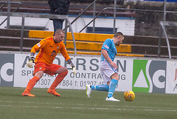 Forfar Athletic's John Baird passes East Fife's sub keeper Daniel Terry and scoring their third goal. half time : Forfar Athletic 3 v 0 East Fife, Scottish Football League Division One game played 2/3/2019 at Forfar Athletic's home ground, Station Park, Forfar.