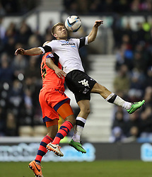 Derby County's Jamie Ward holds off Bolton's Tim Ream - Photo mandatory by-line: Matt Bunn/JMP - Tel: Mobile: 07966 386802 16/02/2014 - SPORT - FOOTBALL - IPro Stadium - Pride Park - Derby - Derby County v Bolton - Sky Bet Championship