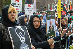 St James, London, May 12th 2016. Tamil, Afghan, Nigerian and Biafran protesters demonstrate outside the anti-corruption conference taking place at Lancaster House. PICTURED: Afghan women protest against Ashraf Ghani's alleged corruption.