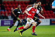Wimbledon midfielder Liam Trotter (14) in action  during the The FA Cup 3rd round match between Fleetwood Town and AFC Wimbledon at the Highbury Stadium, Fleetwood, England on 5 January 2019.