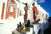 "Luise Kimme is a German sculptor who lives in Tobago since 1979. Her Sculpture Museum, locally called ""The Castle"", overlooks the Mt. Irvine Golf Course with view of the Caribbean Sea. Her unique and  larger than life size Caribbean sculptures are made from oak, cedar, lime, cypress and bronze, depicting perfect portraits of the beautiful Tobagonians..I have photographed this amazing artist and her work since 1996. Together we produced a number of books and catalogues. She shares her self designed 'Castle' with her 8 dogs and 1 cat. They are often the subjects of Luise Kimme's work. More at www.luisekimme.com"