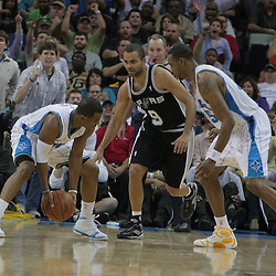 17 December 2008:  New Orleans Hornets guard Chris Paul (3) picks up the ball to break the record NBA record for consecutive games (106) with a steal by taking the ball away from San Antonio Spurs guard Tony Parker (9) during a NBA regular season game between the Western Conference rivals the San Antonio Spurs and the New Orleans Hornets at the New Orleans Arena in New Orleans, LA..
