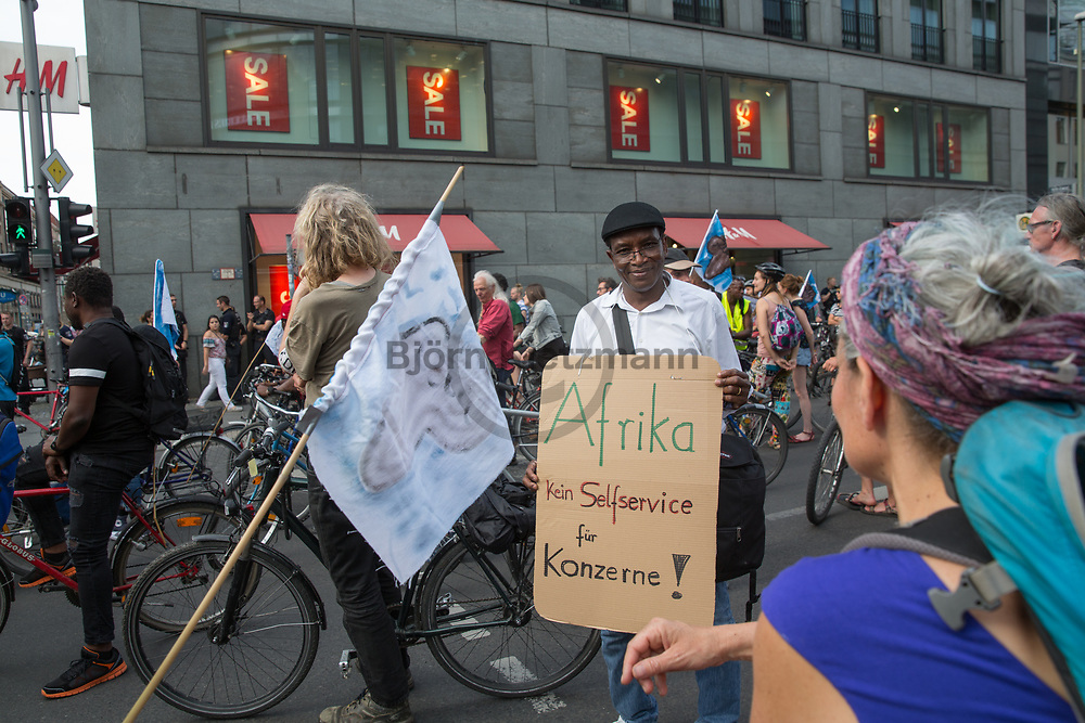 Berlin, Germany - 09.06.2017<br /> <br /> Protest in front of a H&amp;M store. &rdquo;Visitez les profiteurs&quot; bike rally against the upcoming G20-Africa conference.<br /> <br /> Protest vor einem H&amp;M Laden. &rdquo;Visitez les profiteurs&rdquo; Fahrrad Demonstration gegen die bevorstehende G20-Afrika Konferenz.<br /> <br /> Photo: Bjoern Kietzmann