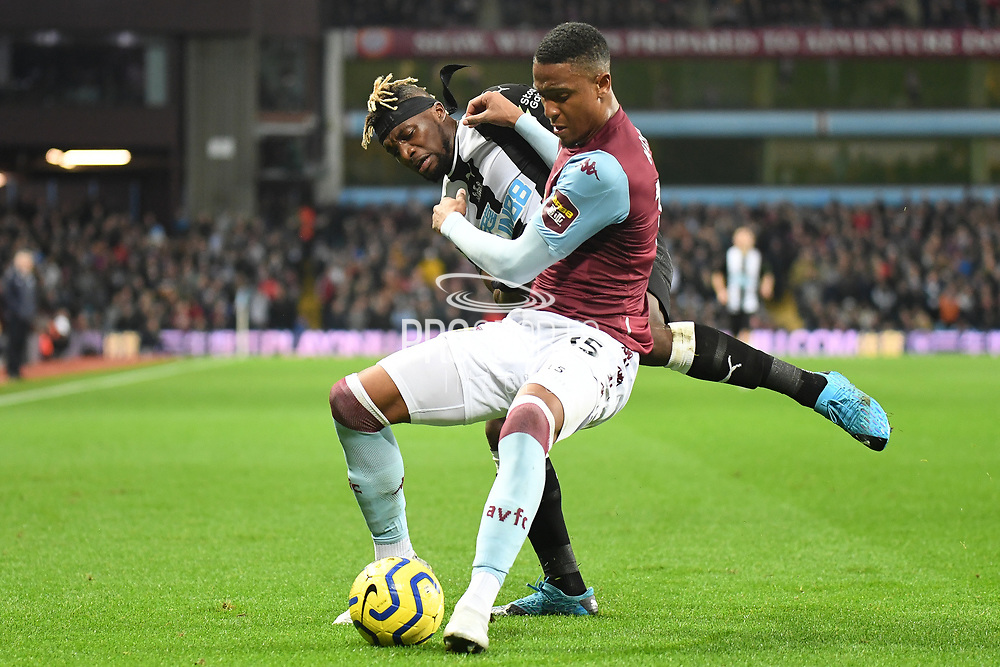 Newcastle United midfielder Allan Saint-Maximin (10) battles for possession  with Aston Villa defender Ezra Konza ( 15) during the Premier League match between Aston Villa and Newcastle United at Villa Park, Birmingham, England on 25 November 2019.