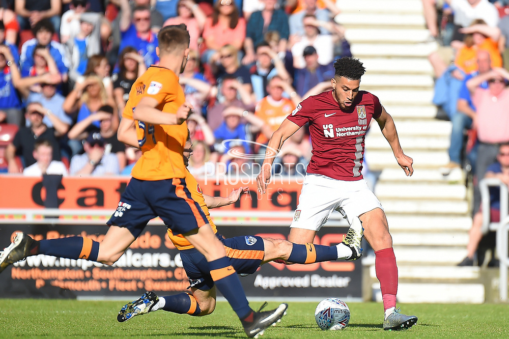 Northampton Town midfielder Daniel Powell (11) takes a shot at goal  during the EFL Sky Bet League 1 match between Northampton Town and Oldham Athletic at Sixfields Stadium, Northampton, England on 5 May 2018. Picture by Dennis Goodwin.