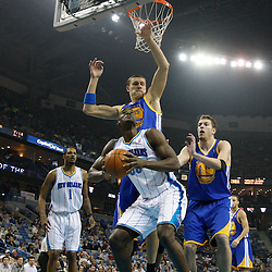 January 5, 2011; New Orleans, LA, USA; New Orleans Hornets center Emeka Okafor (50) is defended under the basket by Golden State Warriors center Andris Biedrins (15) and center David Lee (10) during the first half at the New Orleans Arena.   Mandatory Credit: Derick E. Hingle