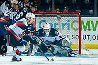 KELOWNA, BC - JANUARY 3: Trevor Wong #8 clears the rebound from in front of Roman Basran #30 of the Kelowna Rockets after making a first period save against the Victoria Royals at Prospera Place on January 3, 2020 in Kelowna, Canada. (Photo by Marissa Baecker/Shoot the Breeze)