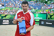 Global SO Ambassador Wladimir Grbic of Serbia shows special souvenir while exhibition match of Special Olympics Poland during Day 7 of the FIVB World Championships on July 7, 2013 in Stare Jablonki, Poland. <br /> <br /> Poland, Stare Jablonki, July 07, 2013<br /> <br /> Picture also available in RAW (NEF) or TIFF format on special request.<br /> <br /> For editorial use only. Any commercial or promotional use requires permission.<br /> <br /> Mandatory credit:<br /> Photo by &copy; Adam Nurkiewicz / Mediasport
