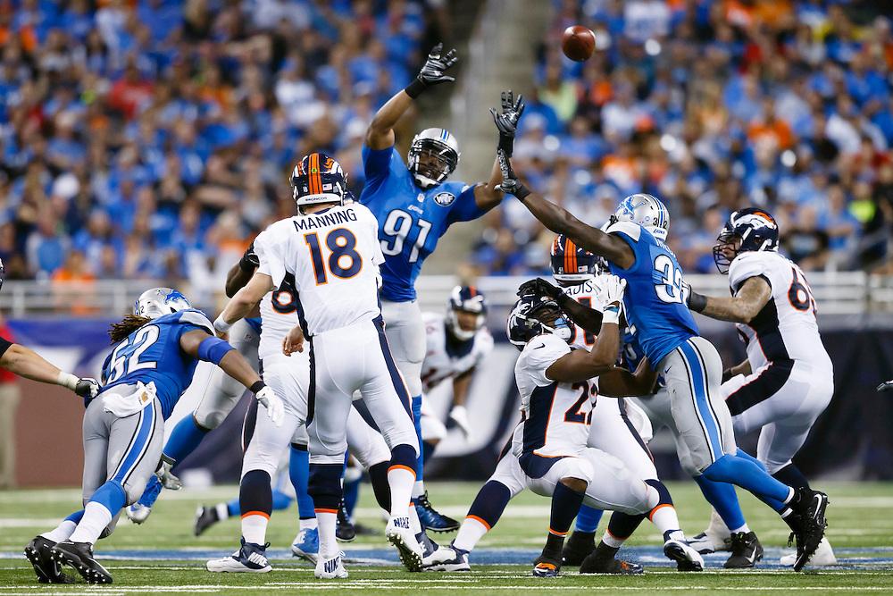 Denver Broncos quarterback Peyton Manning (18) passes over Detroit Lions defensive end Jason Jones (91) during an NFL football game at Ford Field in Detroit, Sunday, Sept. 27, 2015. (AP Photo/Rick Osentoski)