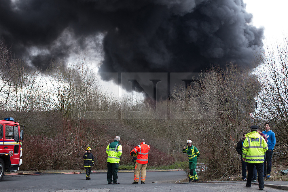 """© Licensed to London News Pictures . 15/03/2015 . Salford , UK . Emergency services at the scene . Roads are closed and people have been evacuated as a large fire burns at a unit within """" Junction Eco-Park """" in Clifton , Greater Manchester , this evening (Sunday 15th March 2015) . The smoke and flames can be seen for many miles . Forty fire fighters are at the scene working to control the blaze . Photo credit : Joel Goodman/LNP"""