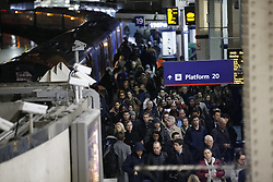 © Licensed to London News Pictures. 09/01/2017. London, UK. Commuters travel by overground trains from Waterloo Station as London Underground services are severely disrupted due to RMT and TSSA unions' 24-hour strike action in a dispute over jobs cuts and closed ticket offices on January 9, 2017. Photo credit: Tolga Akmen/LNP