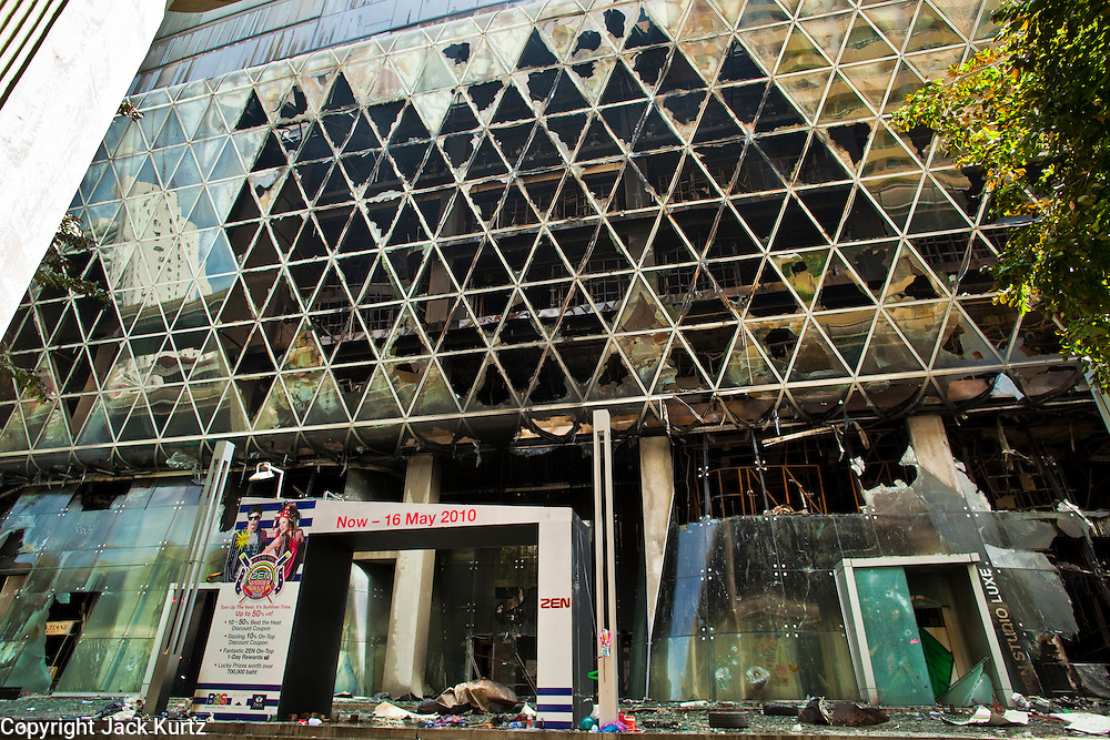 20 MAY 2010 - BANGKOK, THAILAND: Central World, the second largest shopping mall in southeast Asia, was destroyed by arsonist working with the anti government Red Shirts in the Ratchaprasong Intersection in Bangkok Thursday. The day after a military crackdown killed at least six people, Thai authorities continued mopping up operations around the site of the Red Shirt rally stage and battle fires set by Red Shirt supporters in the luxury malls around the intersection. Anti government forces set fire to the mall and several other locations across Bangkok after their leaders surrendered to police.   PHOTO BY JACK KURTZ