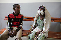 Fred Hollows Foundation Trachoma Program work in Jimma region of southern Ethiopia. Kemal Abagojam 15 sits next to his mother Abagojam 60 who has just come out of trachiasis surgery Seka Chekorsa Primary Hospital.