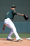 MESA, AZ - MARCH 09:  Sean Manaea #55 of the Oakland Athletics delivers a pitch in of the spring training game against the Cincinnati Reds at HoHoKam Stadium on March 9, 2017 in Mesa, Arizona.  (Photo by Jennifer Stewart/Getty Images)