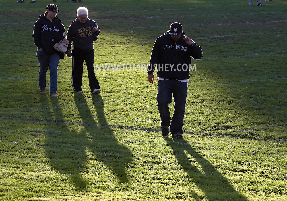 Beacon, New York - Spectators wallk across the field after a high school football game on Saturday, Oct. 10, 2009.